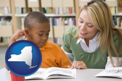 ny a teacher helping a student with reading skills