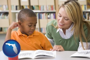 a teacher helping a student with reading skills - with Florida icon